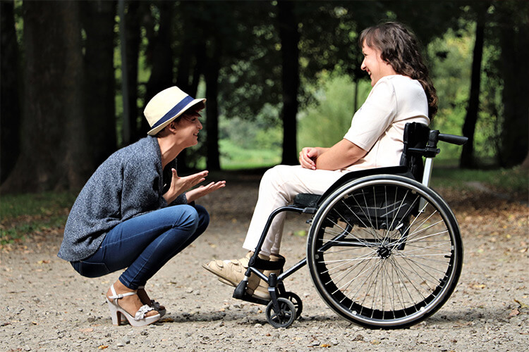 Woman Sitting on Free Wheelchair with Friend