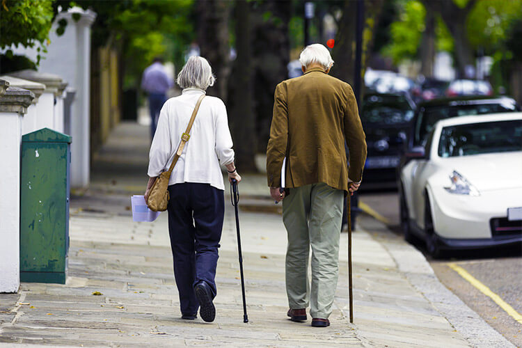 Elderly Couple Walking Properly with Canes