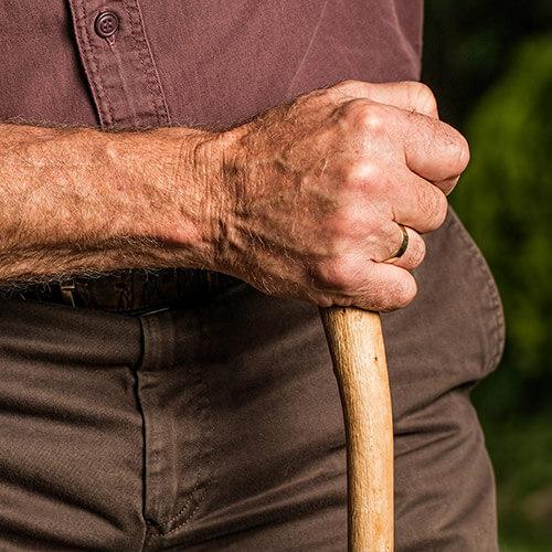 Man Holding Walking Stick