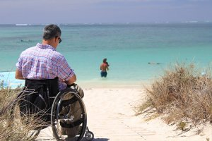 Man in Wheelchair on Wheelchair Accessible Beach