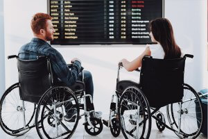 Man and Woman in Wheelchairs at Airport