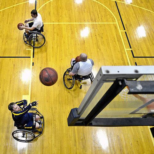 Three Men Playing Wheelchair Basketball