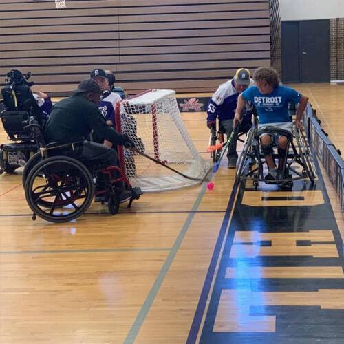Group of Men Playing Wheelchair Hockey