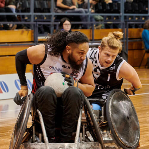 Two Men Playing Wheelchair Rugby