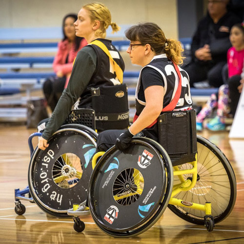 Two Women Playing Wheelchair Soccer
