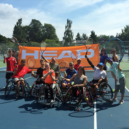 Group of Wheelchair Tennis Players